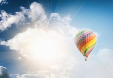 Beautiful bright striped balloon against the blue sky. Travel dr. Eam freedom concept stock photos