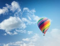 Beautiful bright striped balloon against the blue sky. Travel dr. Eam freedom concept stock photo