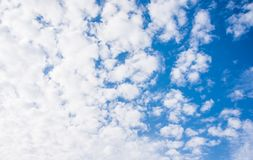Beautiful bright summer sky and clouds. Beautiful puffy white clouds on a blue clear sky. Perfect summer weather stock image
