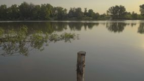 Bright sunset on river. Beautiful bright sunset on river in summer stock footage