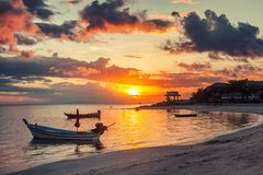 Beautiful bright sunset on the shore of a tropical beach, colorful sky, Thailand royalty free stock image