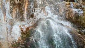 Beautiful bright waterfall in the Republic of Kabardino-Balkaria in Russia. Autumn trip to the Caucasus. Frozen water ice stock video