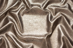 Beautiful brilliant silk wavy bronze fabric Stock Images