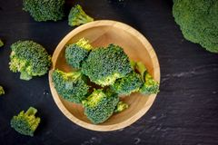 Free Beautiful Broccoli Florets On A Wooden Plate On A Slate Board. Stock Photo - 112064070