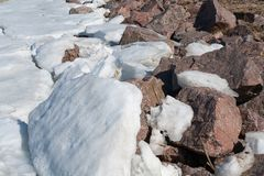 Beautiful broken ice background and granite stone top view stock images