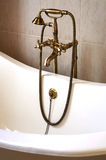 The beautiful bronze faucet Stock Photography