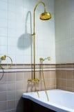 Beautiful bronze faucet Stock Images