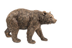 Bronze statue of a brown bear. Beautiful bronze figurine of a large brown bear isolated on white background stock photo