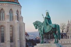 Beautiful bronze king Stephen I monument in. Picture of hungarian king Stephen I monument in Budapest. Beautiful bronze rider on blurred morning cityscape royalty free stock photo