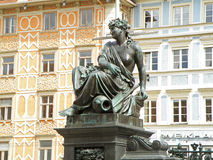 Beautiful bronze statue with the pastel colored buildings at the main square of Glaz. Austria Royalty Free Stock Photo