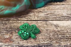 Beautiful brooch in the form of clover. Royalty Free Stock Photos