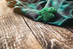 Beautiful brooch in the form of clover. Stock Photos