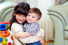 Beautiful brother and sister embracing at home Royalty Free Stock Photos