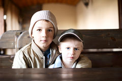 Beautiful brothers at the table Stock Image