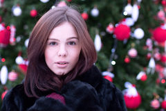Beautiful brown-eyed brunette girl  winter  black coat posing  background trees, fashion style concept idea, portrait Stock Images