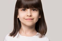 Beautiful brown-eyed brown-haired little girl closeup studio portrait royalty free stock photography