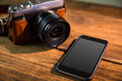 A beautiful brown fashioned camera. On the wodden table Royalty Free Stock Photos
