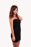 Beautiful brown hair woman in elegant black dress Stock Photos