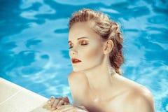 Beautiful brown hair woman near water wearing bikini. Stock Images