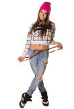 Beautiful brown-haired woman in a cap and jeans Royalty Free Stock Photos
