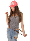 Beautiful brown-haired woman in a cap and jeans Royalty Free Stock Photography