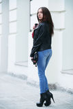 The beautiful brown-haired woman with a scarf on high heels Stock Photo