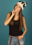 Beautiful brown-haired woman in winter hat and jeans Stock Photography