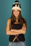 Beautiful brown-haired woman in winter hat and jeans Royalty Free Stock Images