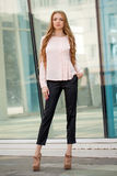 Beautiful brown-haired young woman wearing clothes and walking o Stock Photo