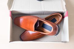 Beautiful brown leather men`s shoes. In box Stock Image