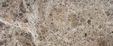 Brown Marble Stone. Beautiful brown marble surface with gravel chaotic texture Royalty Free Stock Photos