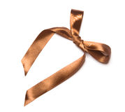 Beautiful brown ribbon and bow, good for design. Isolated on a white background Royalty Free Stock Photos
