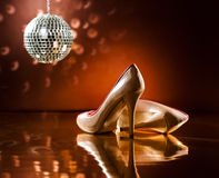 Beautiful brown stilettos on the dance floor Royalty Free Stock Photography