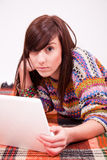 Beautiful brown teen girl with laptop Royalty Free Stock Photo
