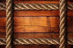Wood texture and ropes Royalty Free Stock Photos
