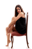 Beautiful brunette on a chair Stock Photo
