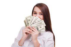 Beautiful brunet with dollars on a white background. Young business woman showing money on cam stock images
