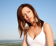 Beautiful Brunet Portrait Under a Blue Sky Royalty Free Stock Image