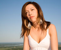Beautiful Brunet Portrait Under a Blue Sky Stock Photo