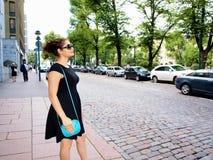 Beautiful brunet in street Stock Image