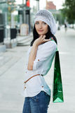 Beautiful brunet woman after shopping. Outdoor shot Royalty Free Stock Photos