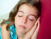 Beautiful brunete kid girl sleeping hands together Royalty Free Stock Photography