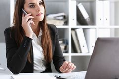 Beautiful brunett smiling businesswoman talk. Cellphone in office portrait Stay in touch best cellular price white collar busy life style electronic device royalty free stock photo