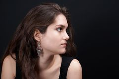 Beautiful brunette. On black background stock photo
