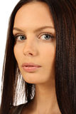 Beautiful brunette. Portrait of beautiful young brunette woman with healthy long hair Stock Images