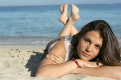 Beautiful brunette. Beautiful young woman resting on the beach Royalty Free Stock Images