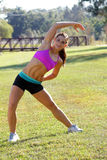 Beautiful Brunette Ahtlete Stretches Outdoors (3) Royalty Free Stock Image