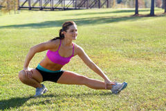 Beautiful Brunette Ahtlete Stretches Outdoors (5) Royalty Free Stock Image