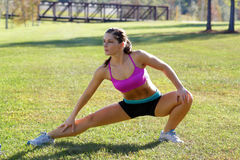 Beautiful Brunette Ahtlete Stretches Outdoors (6) Stock Image