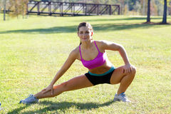 Beautiful Brunette Ahtlete Stretches Outdoors (7) Stock Images